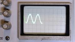 Pulses and sine wave on the screen of an old oscilloscope - stock footage