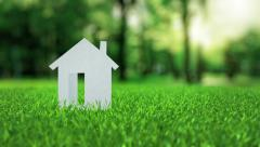 White paper house animation on green nice summer grass mortgage concept Stock Footage