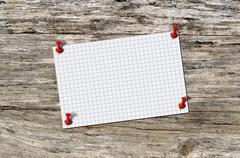 Blank paper memo on wood - stock photo