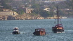 Three motor boats are floating on bay. Black Sea. Sevastopol, Crimea. - stock footage