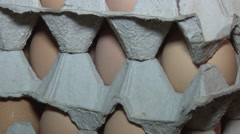 Eggs stacked on carton - stock footage