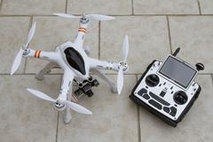 Stock Photo of Quadcopter with radio transmitter