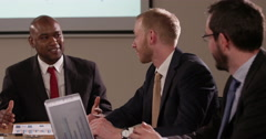 Corporate business team in a boardroom meeting. In slow motion - stock footage