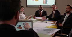 Team of multi ethnic business people in a meeting. In slow motion. - stock footage