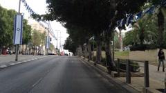 Raanana streets - A pedestrian crosses a red light crosswalk Stock Footage