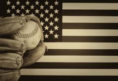 Worn baseball glove and used ball on American Flag Kuvituskuvat