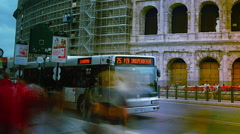 Cars and buses on street in front of Colosseum, time lapse, 4k, Stock Footage