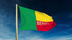 Benin flag slider style with title. Waving in the wind with cloud background Stock Footage