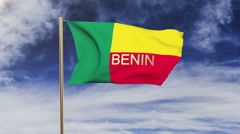 Benin flag with title waving in the wind. Looping sun rises style.  Animation Stock Footage