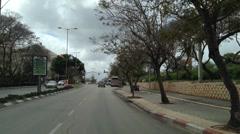Driving in Kfar Sava Street near Meir Hosptal Stock Footage