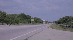 White truck driving on a paved road in the Crimea Stock Footage