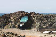A rock arch near Ajuy in Fuerteventura, Spain - stock photo