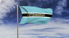 Botswana flag with title waving in the wind. Looping sun rises style.  Animation Arkistovideo