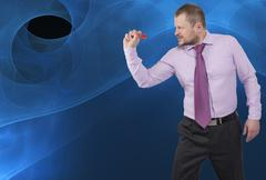 Businessman aiming by dart on abstract background - stock photo