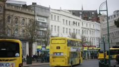 English town (Bournemouth) with a yellow double decker Stock Footage