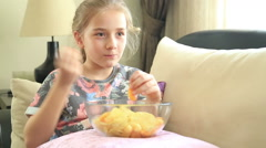 Happy little girl eating potato chip Stock Footage