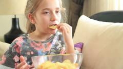 Little girl eating potato chip Stock Footage