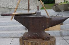 Old hammer and rusty anvil. Stock Photos