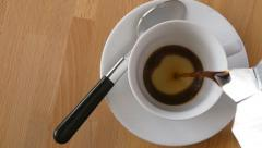Pouring coffee into cup, slow motion Stock Footage