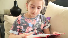 Little girl reading book 2 Stock Footage