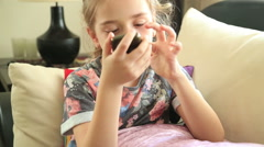 Cute little girl speaking on the mobile phone Stock Footage