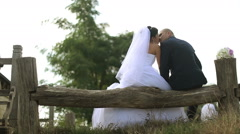 Kissing couple sitting on the machine too Stock Footage