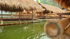 Bamboo raft on the reservoir's dam - stock footage