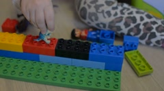 A young child plays in the constructor Stock Footage
