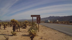 Cholla Gardens Sign And Parking Lot- JTNP Stock Footage