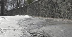 Melting ice on road -  4K Stock Footage