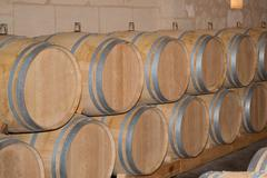 Wine cellar with barrels in stacks - stock photo