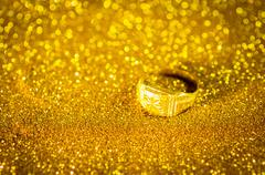 Golden Ring on gold colour abstract. - stock photo
