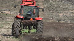 April farmer plowing field for spring planting 4K 023 Stock Footage