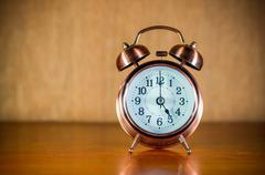 Retro alarm clock on table Stock Photos