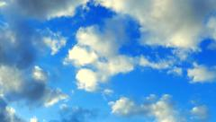 Fluffy Clouds Drift by in Saturated Blue Sky, Time Lapse Stock Footage
