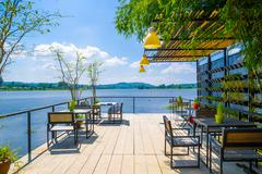 Outdoor restaurant with beautiful view on Lake. - stock photo