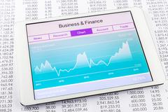 Chart or graph with stock market data application on tablet Stock Photos