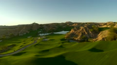 Aerial view of golf course fly over with lens flare Stock Footage