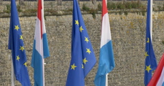 Luxembourg city luxembourger flag and European union flags EU Euro Europe waving Stock Footage