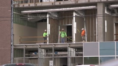 3 constructions workers on an industrial construction site Stock Footage