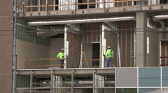 3 constructions workers on an industrial construction site 02 Stock Footage