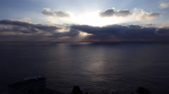 4K Time Lapse of Sunshine through Heavenly Clouds over Ocean -Tilt Up- Stock Footage