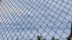 Time Lapse Clouds Through Fence Lines Stock Footage
