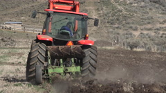 April farmer plowing field for spring planting fast 4K 023 Stock Footage