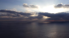 4K Time Lapse of Sunshine through Heavenly Clouds over Ocean -Pan Right- Stock Footage