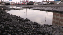 Stock Video Footage of Large pothole on city street and crumbling roads and infrastructure in Toronto