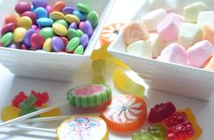 Two bowls of colored smarties and sour candies - stock photo