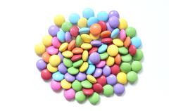 Isolated colored smarties on white background - stock photo