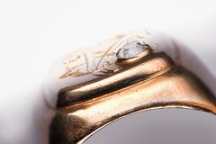 Old scratched golden ring with diamond fissure Stock Photos