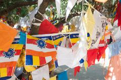 Kandy Sri Lanka Royal Palace complex. Prayer flags. - stock photo